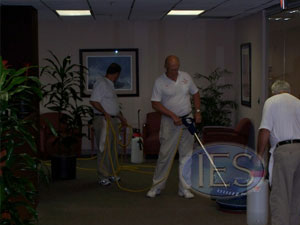 Carpet cleaning crew during a carpet cleaning job in Calvert County