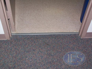 Transition from carpet to hard surface in need of repair _After