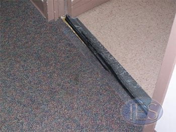 BEFORE: Carpet Transition Needing Repair