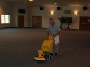 Carpet cleaning technician using Cimex Low Moisture Carpet Cleaning Machine