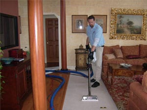 Carpet-cleaning-technician-using-Hot-water-extraction-carpet-cleaning